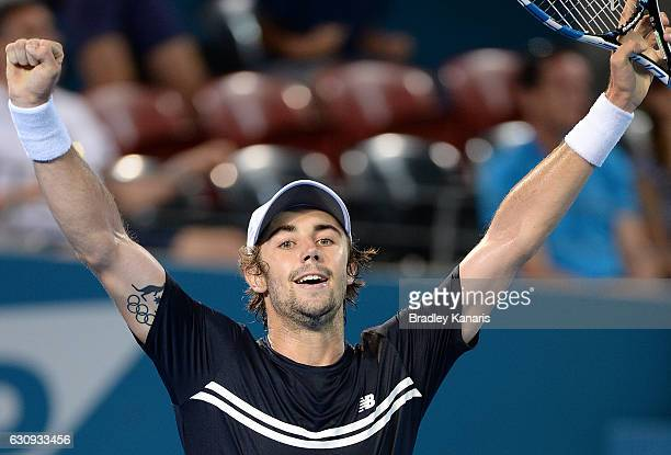 Jordan Thompson of Australia celebrates victory after his match against David Ferrer of Spain on day four of the 2017 Brisbane International at Pat...