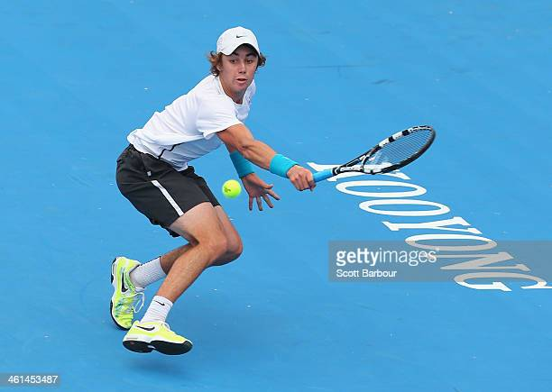 Jordan Thompson of Australia plays a backhand during his match against Mikhail Youzhny of Russia during day two of the AAMI Classic at Kooyong on...
