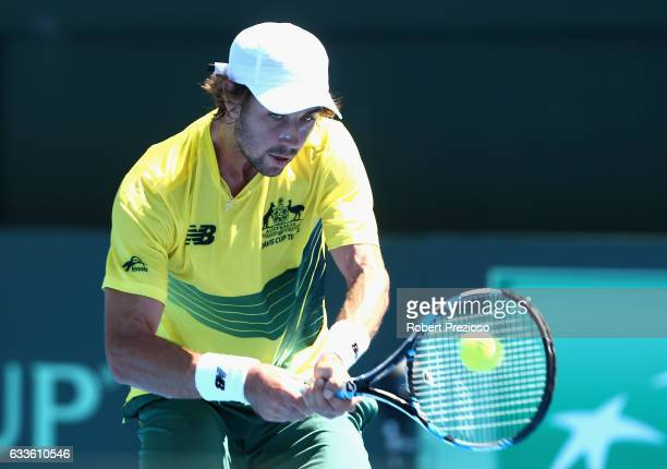 Jordan Thompson of Australia plays a backhand in his singles match against Jiri Vesely of Czech Republic during the first round World Group Davis Cup...