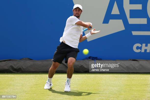 Jordan Thompson of Australia plays a backhand shot during the qualifying match against Jeremy Chardy of France ahead of the Aegon Championships at...