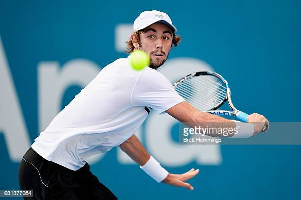 Jordan Thompson of Australia plays a backhand shot in his first round match against Nikoloz Basilashvili of Georgia during day three of the 2017...
