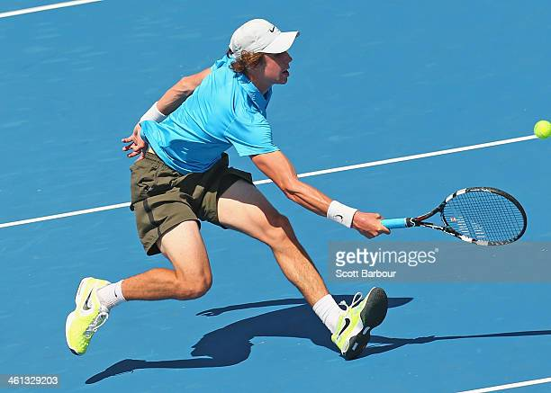 Jordan Thompson of Australia plays a forehand during his match against Richard Gasquet of France during day one of the 2014 AAMI Classic at Kooyong...