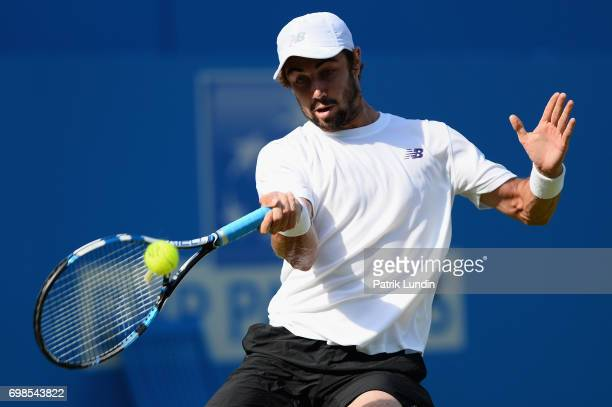 Jordan Thompson of Australia plays a forehand during the mens singles first round match against Andy Murray of Great Britain on day two of the 2017...