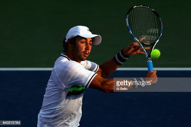 Jordan Thompson of Australia returns a shot during his first round Men's Singles match against Jack Sock of the United States on Day One of the 2017...
