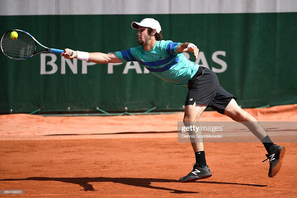 <a gi-track='captionPersonalityLinkClicked' href=/galleries/search?phrase=Jordan+Thompson+-+Tennis+Player&family=editorial&specificpeople=12328869 ng-click='$event.stopPropagation()'>Jordan Thompson</a> of Australia stretches for a forehand during the Men's Singles second round match against Ivo Karlovic of Croatia at Roland Garros on May 25, 2016 in Paris, France.