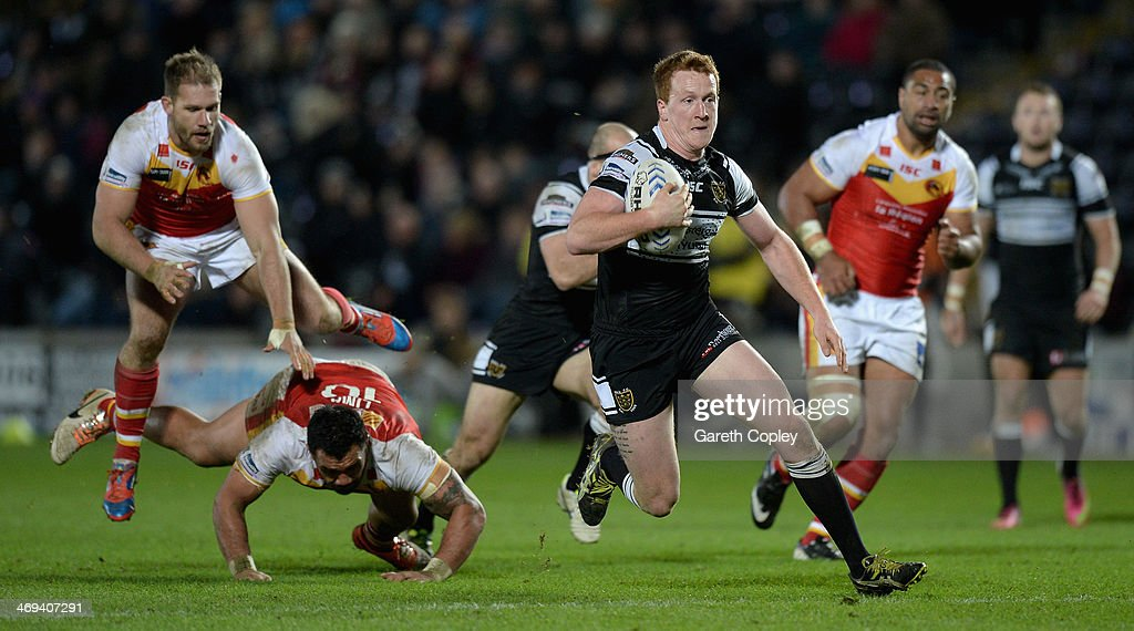 Jordan Thompson of Hull FC breaks the Catalans defensive line on his way to scoring his second half try during the Super League match between Hull FC...