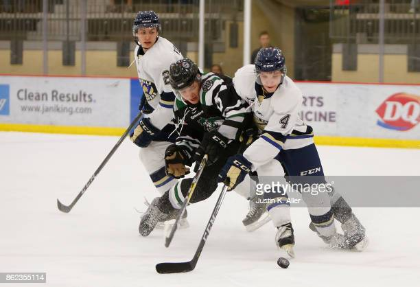 Jordan Timmons of the Cedar Rapids RoughRiders battles against Brandon Tabakin of the Sioux Falls Stampede for a loose puck during the game on Day 2...