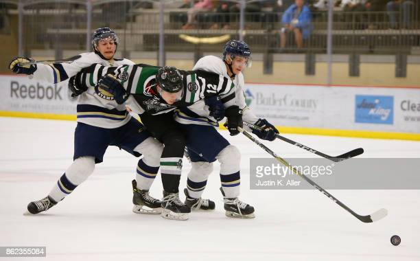 Jordan Timmons of the Cedar Rapids RoughRiders battles for a loose puck during the game against the Sioux Falls Stampede on Day 2 of the USHL Fall...