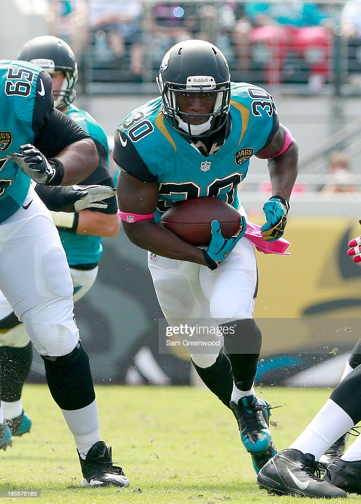 Jordan Todman #30 of the Jacksonville Jaguars runs for yardage during the game at EverBank Field on October 20, 2013 in Jacksonville, Florida.