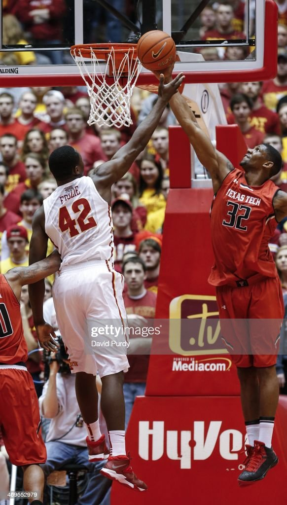 Jordan Tolbert #32 of the Texas Tech Red Raiders blocks a shot by Daniel Edozie #42 of the Iowa State Cyclones in the second half of play at Hilton Coliseum on February 15, 2014 in Ames, Iowa. Iowa State defeated Texas Tech 70-64.