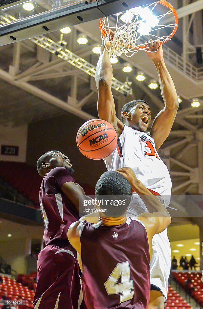Jordan Tolbert of the Texas Tech Red Raiders dunks the basketball during game action against the Texas Southern Tigers on November 18 2013 at United...