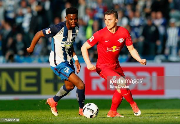 Jordan Torunarigha of Hertha BSC challenges Marcel Sabitzer of RB Leipzig during the Bundesliga match between Hertha BSC and RB Leipzig at...