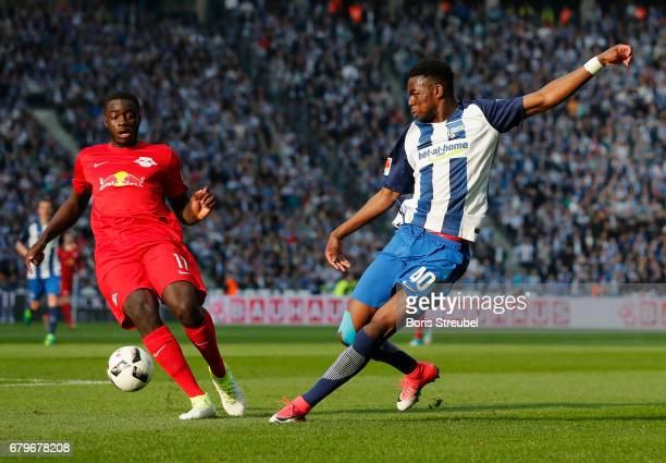 Jordan Torunarigha of Hertha BSC is challenged by Dayot Upamecano of RB Leipzig during the Bundesliga match between Hertha BSC and RB Leipzig at...