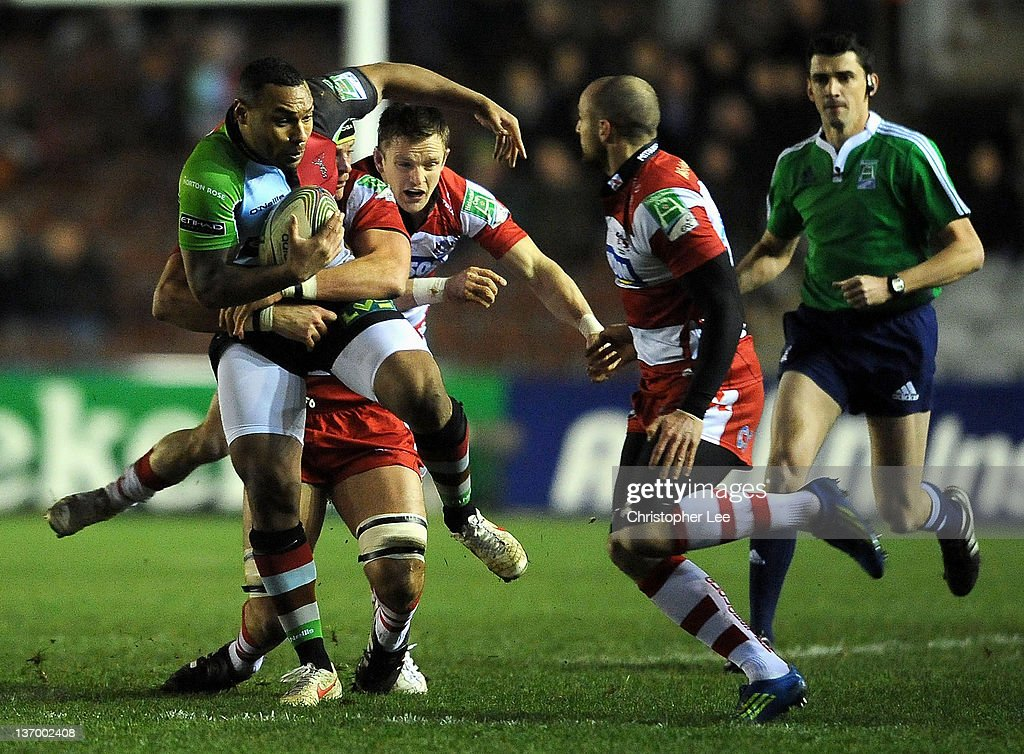 Jordan Turner Hall of Quins is tackled by Alex Brown of Gloucester during the Heineken Cup Pool 6 match between Harlequins and Gloucester at...