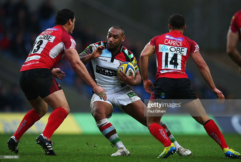 <a gi-track='captionPersonalityLinkClicked' href=/galleries/search?phrase=Jordan+Turner-Hall&family=editorial&specificpeople=2375230 ng-click='$event.stopPropagation()'>Jordan Turner-Hall</a> of Harlequins is closed down by Seb Jewell and Dan Caprice of London Weslsh during the Aviva Premiership match between London Welsh and Harlequins at Kassam Stadium on January 6, 2013 in Oxford, England.