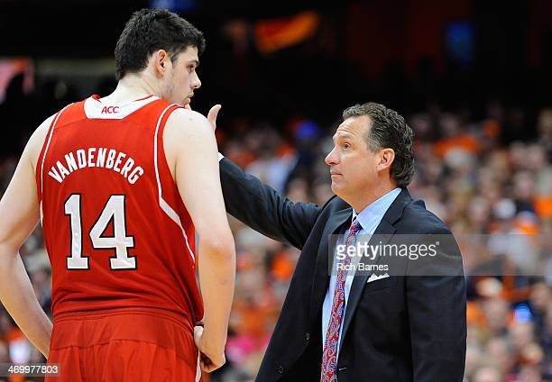 Jordan Vandenberg of the North Carolina State Wolfpack talks with head coach Mark Gottfried during the first half at the Carrier Dome on February 15...