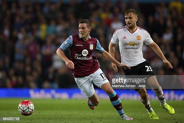 Jordan Veretout of Aston Villa and Luke Shaw of Manchester United during the Barclays Premier League match between Aston Villa and Manchester United...