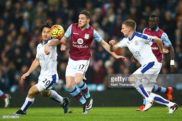 Jordan Veretout of Aston Villa competes against Shinji Okazaki and Marc Albrighton of Leicester City during the Barclays Premier League match between...