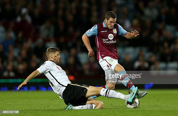 Jordan Veretout of Aston Villa is challenged by Jonathan Stead of Notts County during the Capital One Cup second round match between Aston Villa and...