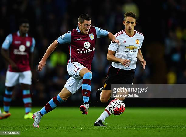 Jordan Veretout of Aston Villa is marshalled by Adnan Januzaj of Manchester United during the Barclays Premier League match between Aston Villa and...