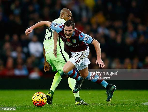 Jordan Veretout of Aston Villa is tackled by Fernandinho of Manchester City during the Barclays Premier League match between Aston Villa and...