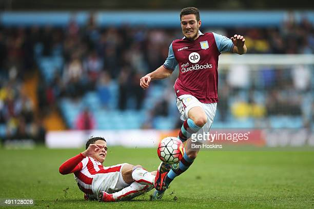 Jordan Veretout of Aston Villa is tackled by Ibrahim Afellay of Stoke City during the Barclays Premier League match between Aston Villa and Stoke...