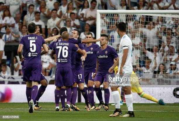 Jordan Veretout of Fiorentina celebrates with his teammates after scoring a goal during a Santiago Bernabeu Cup soccer match between Real Madrid and...