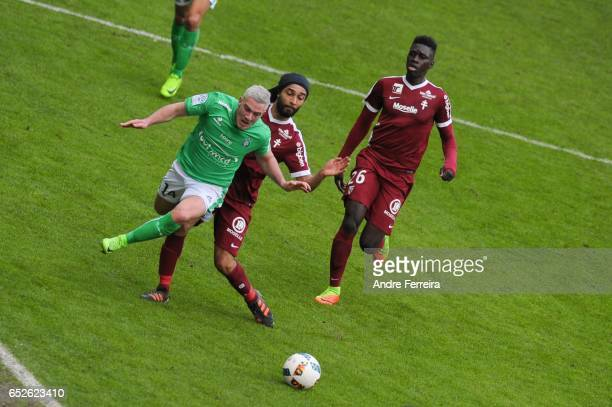 Jordan Veretout of Saint Etienne and Benoit Assou Ekotto of Metz and Ismaila Sarr of Metz during the French Ligue 1 match between Saint Etienne and...