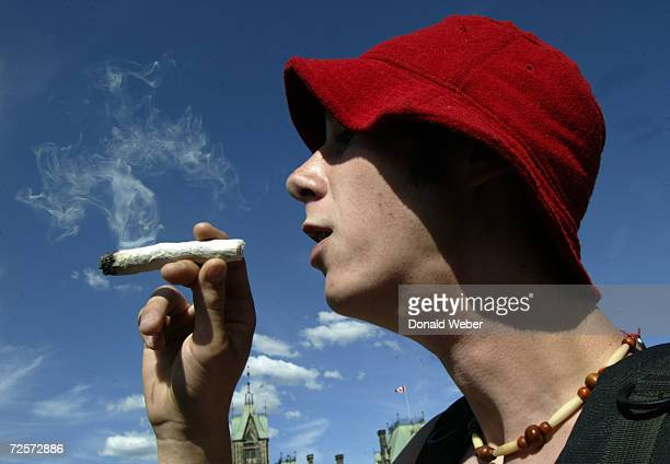 Jordan Ward of Kingston Ontario smokes a giant joint during a rally in support of legalizing marijuana on June 5 2004 on Parliament Hill in Ottawa...