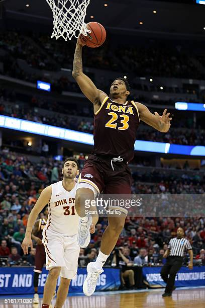 Jordan Washington of the Iona Gaels dunks the ball over Georges Niang of the Iowa State Cyclones during the first round of the 2016 NCAA Men's...