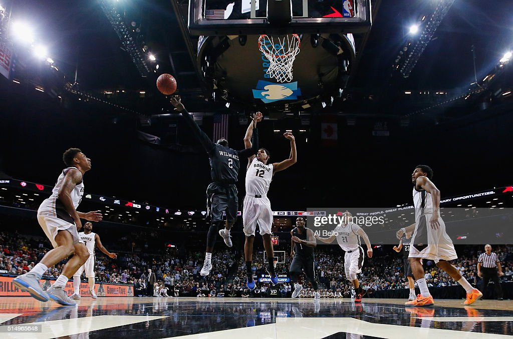 Jordan Watkins of the Davidson Wildcats shoots against Denzel Gregg of the St Bonaventure Bonnies during the Quarterfinals of the Atlantic 10...