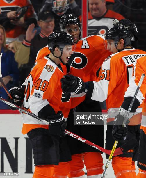 Jordan Weal of the Philadelphia Flyers celebrates his first period goal against the New York Islanders with teammates Wayne Simmonds and Valtteri...