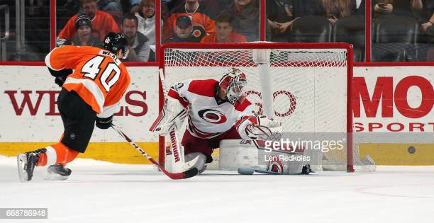 Jordan Weal of the Philadelphia Flyers shoots the puck wide of goaltender Eddie Lack of the Carolina Hurricanes during the shootout on April 9 2017...