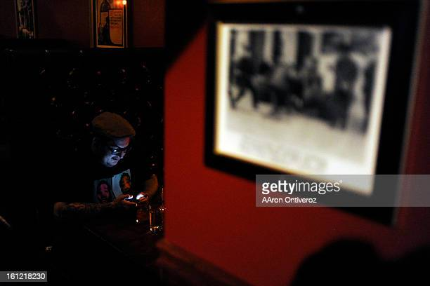 Jordan Weinstein plays with his phone at Williams Graham a recentlyopened speakeasy in the Highlands on Tuesday January 10 2012 AAron Ontiveroz The...