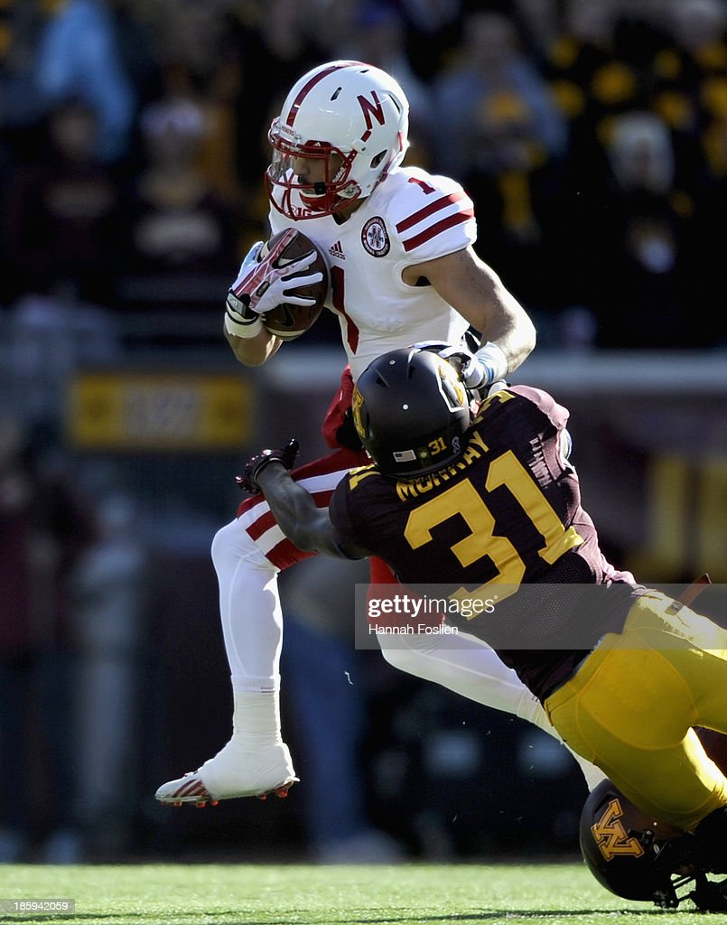 Jordan Westerkamp #1 of the Nebraska Cornhuskers avoids a tackle by Eric Murray #31 of the Minnesota Golden Gophers during the first quarter of the game on October 26, 2013 at TCF Bank Stadium in Minneapolis, Minnesota.