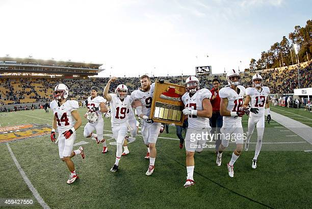 Jordan Williamson Henry Anderson and AJ Tarpley of the Stanford Cardinal celebrate with the Axe after they defeated the California Golden Bears at...