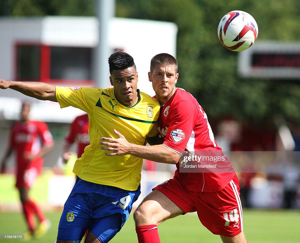 Jordan Willis of Coventry (l) takles for hte ball with Jamie Proctor of Crawley Town (r) during the Sky Bet League One match between Crawley Town FC and Coventry at Broadfield Stadium on August 03, 2013 in Crawley, West Sussex,