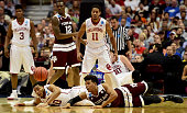 Jordan Woodard of the Oklahoma Sooners and Admon Gilder of the Texas AM Aggies go after a loose ball in the second half in the 2016 NCAA Men's...