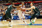 Jordan Woodard of the Oklahoma Sooners drives to the basket against Lourawls Nairn Jr #11 and Colby Wollenman of the Michigan State Spartans in the...