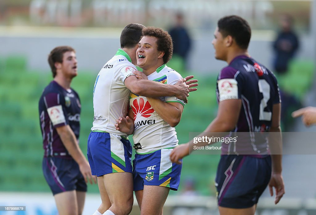 Jordan Worboys of the Raiders is congratulated by his teammates after scoring a try during the round eight Holden Cup match between the Melbourne Storm and the Canberra Raiders at AAMI Park on May 4, 2013 in Melbourne, Australia.