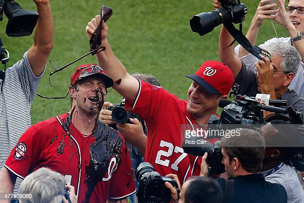 Jordan Zimmermann dumps chocolate syrup over starting pitcher Max Scherzer of the Washington Nationals after throwing a 60 no hitter against the...