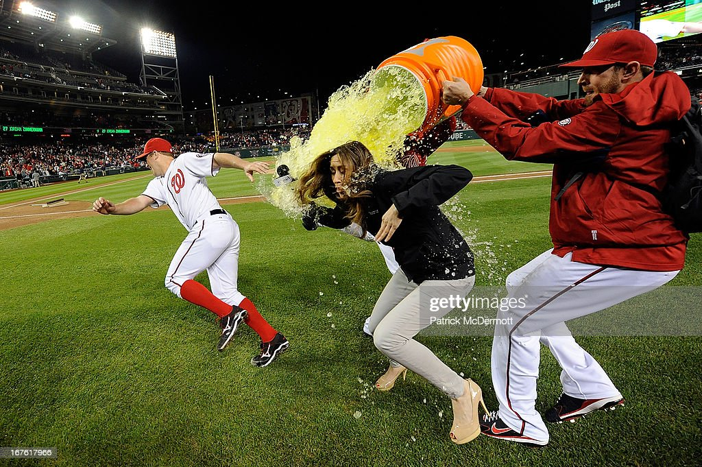 Jordan Zimmermann #27 of the Washington Nationals and MASN's sideline reporter Julie Alexandria are dunked with gatorade by <a gi-track='captionPersonalityLinkClicked' href=/galleries/search?phrase=Drew+Storen&family=editorial&specificpeople=5926519 ng-click='$event.stopPropagation()'>Drew Storen</a> #22 and <a gi-track='captionPersonalityLinkClicked' href=/galleries/search?phrase=Ryan+Mattheus&family=editorial&specificpeople=5437096 ng-click='$event.stopPropagation()'>Ryan Mattheus</a> #52 of the Nationals after they defeated the Cincinnati Reds 1-0 at Nationals Park on April 26, 2013 in Washington, DC.
