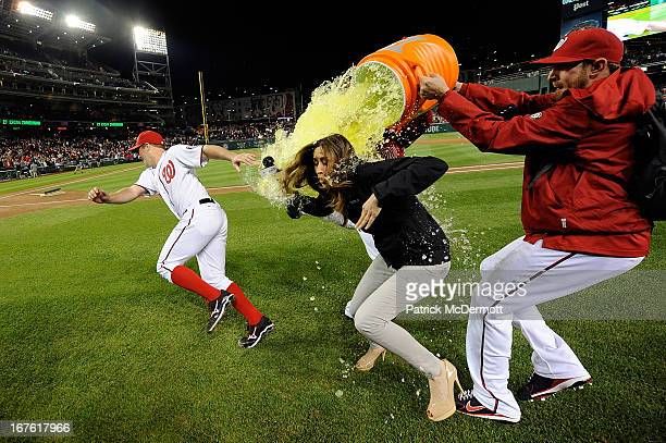 Jordan Zimmermann of the Washington Nationals and MASN's sideline reporter Julie Alexandria are dunked with gatorade by Drew Storen and Ryan Mattheus...