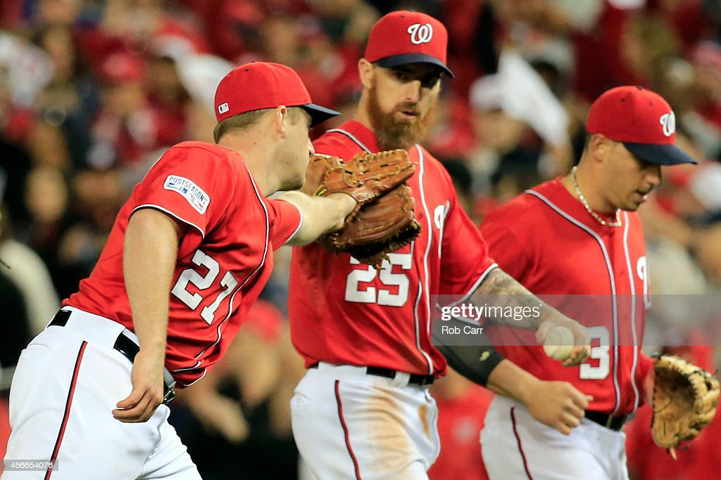 Jordan Zimmermann #27 of the Washington Nationals celebrates with <a gi-track='captionPersonalityLinkClicked' href=/galleries/search?phrase=Adam+LaRoche&family=editorial&specificpeople=216533 ng-click='$event.stopPropagation()'>Adam LaRoche</a> #25 after the third out in the eighth inning against the San Francisco Giants during Game Two of the National League Division Series at Nationals Park on October 4, 2014 in Washington, DC.