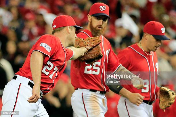 Jordan Zimmermann of the Washington Nationals celebrates with Adam LaRoche after the third out in the eighth inning against the San Francisco Giants...