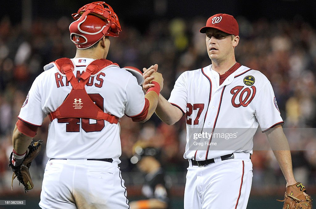 Jordan Zimmermann #27 of the Washington Nationals celebrates with teammate <a gi-track='captionPersonalityLinkClicked' href=/galleries/search?phrase=Wilson+Ramos&family=editorial&specificpeople=4866956 ng-click='$event.stopPropagation()'>Wilson Ramos</a> #40 after pitching a complete game shutout against the Miami Marlins at Nationals Park on September 20, 2013 in Washington, DC.
