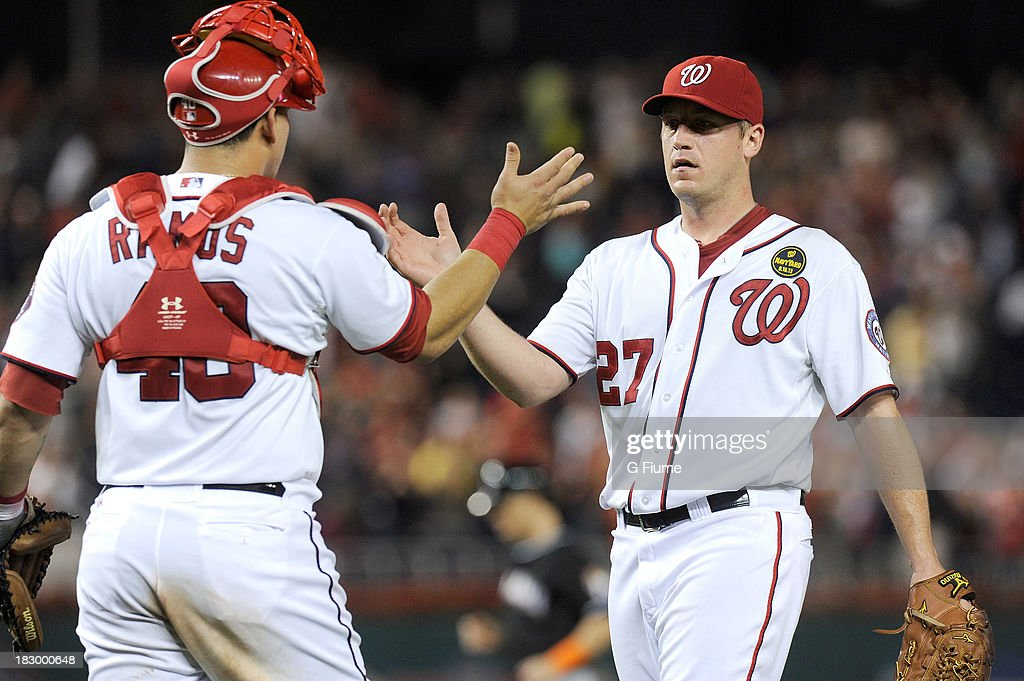 Jordan Zimmermann #27 of the Washington Nationals celebrates with Wilson Ramos #40 after pitching a complete game shutout against the Miami Marlins at Nationals Park on September 20, 2013 in Washington, DC.