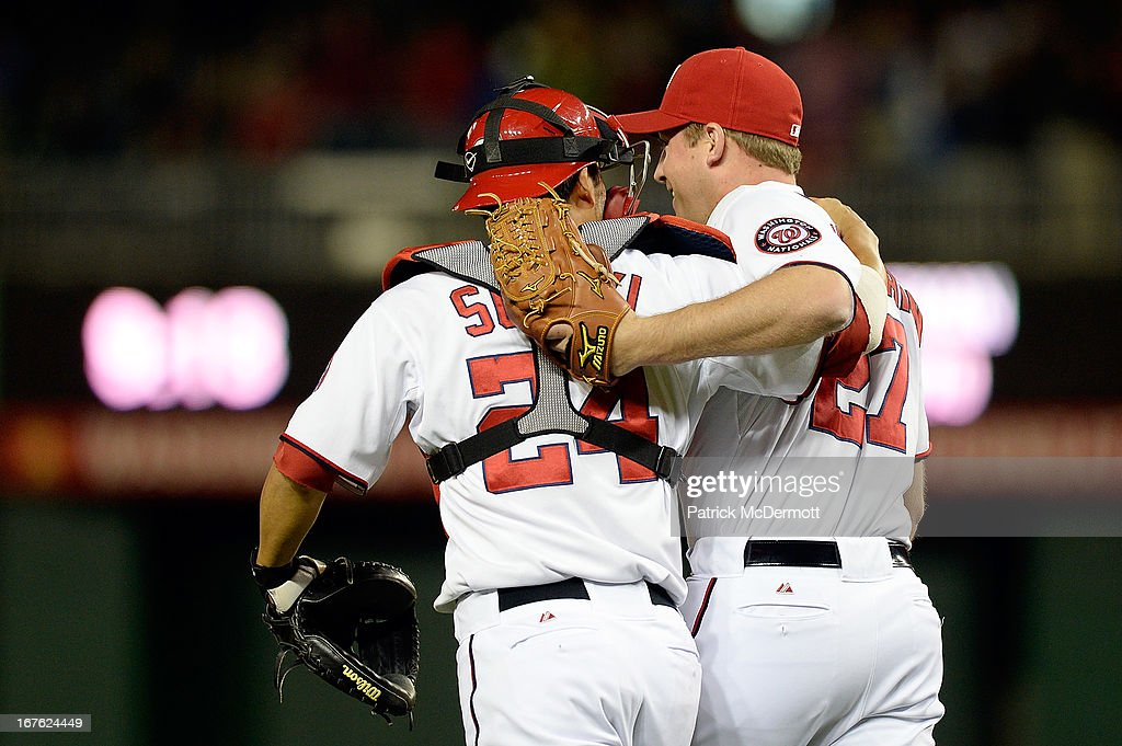 Jordan Zimmermann #27 of the Washington Nationals is congratulated by <a gi-track='captionPersonalityLinkClicked' href=/galleries/search?phrase=Kurt+Suzuki&family=editorial&specificpeople=682702 ng-click='$event.stopPropagation()'>Kurt Suzuki</a> #24 after throwing a one hit complete game shutout against the Cincinnati Reds at Nationals Park on April 26, 2013 in Washington, DC. The Nationals defeated the Reds 1-0.