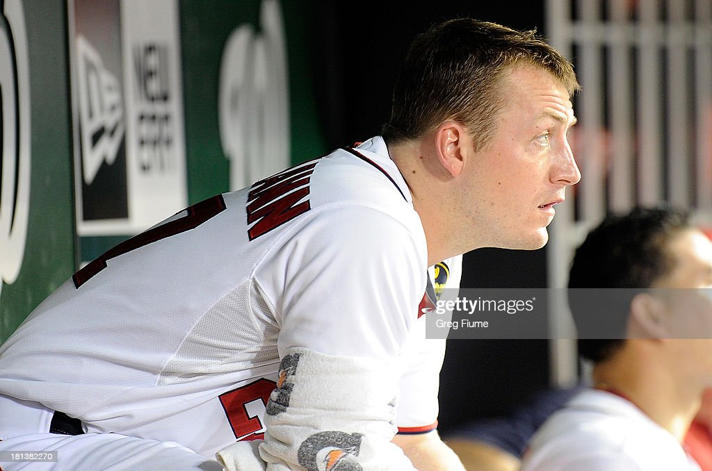 Jordan Zimmermann #27 of the Washington Nationals sits in the dugout watching the game in the sixth inning against the Miami Marlins at Nationals Park on September 20, 2013 in Washington, DC. Washington won the game 8-0.