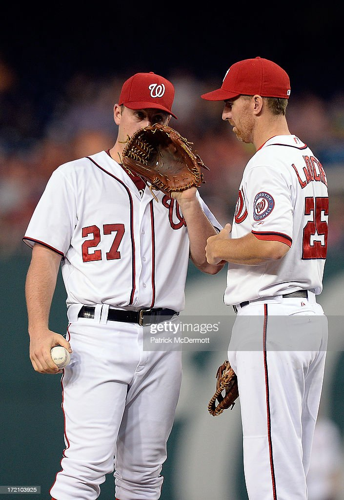 Jordan Zimmermann #27 of the Washington Nationals talks with <a gi-track='captionPersonalityLinkClicked' href=/galleries/search?phrase=Adam+LaRoche&family=editorial&specificpeople=216533 ng-click='$event.stopPropagation()'>Adam LaRoche</a> #25 in the fourth inning during a game against the Milwaukee Brewers at Nationals Park on July 1, 2013 in Washington, DC.